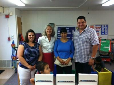 McCollum Assistant Principal Ramoncita Garcia, Principal Carrie McGill, teacher Angel McCarter and Mr. Trujillo with Angel's class.