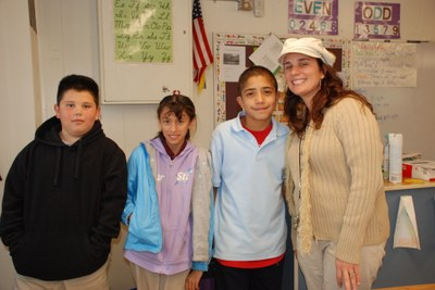 Andrea Villano, recipient of the Pepsi/APS Teacher of the Month award, poses with some of her students.