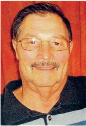 A closeup of a smiling Joe Salas
