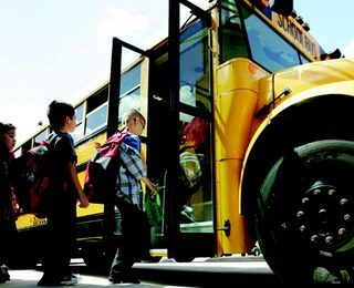 Image of children getting on a bus