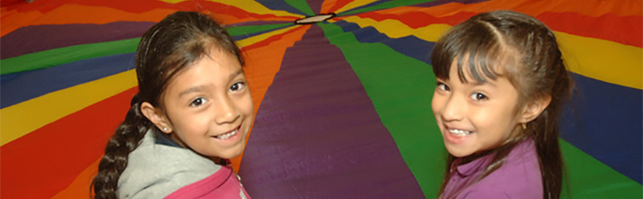 Students Smiling in front of Primary School Parachute