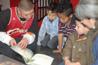 Group of students reading with a teacher