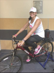 Vanessa Olguin on stationary bike